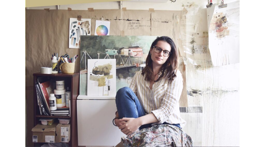Photo of the artist Valentina Gonzalez saez with original paintings in the background