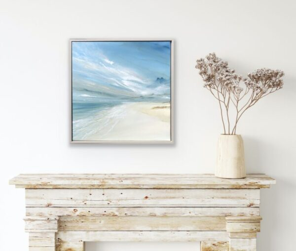 beach painting above a fireplace