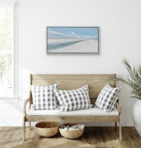seascape beach painting with blue sky sand in a home setting
